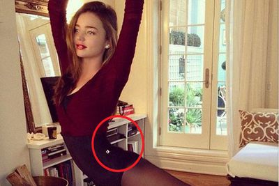 Apparently, not even pencil-thin Miranda Kerr thinks she's skinny enough. <br/><br/>While stretching out in her ballet gear, the former <I>Victoria's Secret</I> model felt the need to slim down her teeny-tiny waist and butt. <br/><br/>Check out the curved dresser behind her which aligns with her lower back! <br/>