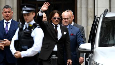 Johnny Depp waves as he leaves the Royal Courts of Justice, Strand on July 10, 2020 in London, England