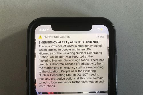 """An emergency alert issued by the Canadian province of Ontario reporting an unspecified """"incident"""" at a nuclear plant is shown on a smartphone. Ontario Power Generation later sent a message saying the alert was sent in error. The initial message said the incident had occurred at the Pickering Nuclear Generating Station, though it added there had been no abnormal release of radioactivity from the station."""