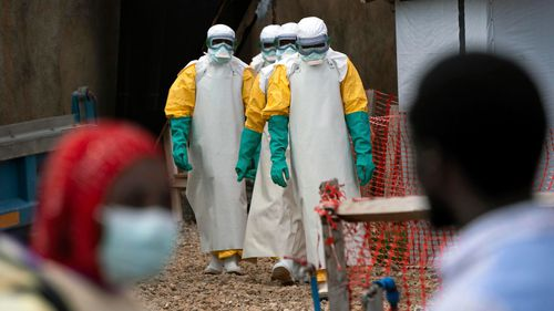 Health workers wearing protective gear begin their shift at an Ebola treatment center in Beni, Congo.