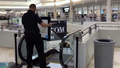 Two-year-old dies after falling from dad's arms on escalator