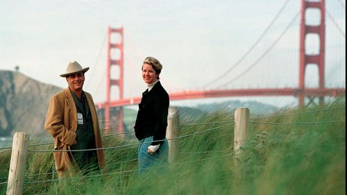 Larry Harvey, left, and Marian Goodell, two of the founders of the Burning Man festival walk near Baker Beach in San Francisco. (AP)