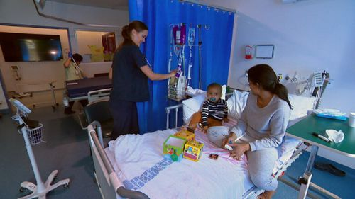 Nurse Rachel Bell tends to a patient.