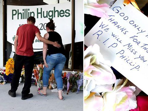 Mourners lay flowers at one of several makeshift shrines to Phillip Hughes, who will be farewelled at a funeral today. (9NEWS)