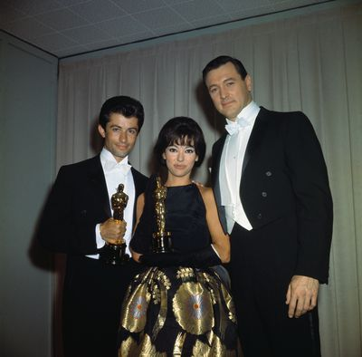 Actress Rita Moreno, best known for her roles in musical films like <em>West Side Story </em>shines in a gold and black gown at the 1962 Annual Academy Awards.