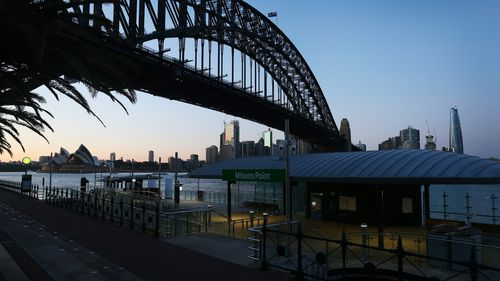 The Sydney Harbour Bridge is seen at sunrise from Milsons Point.