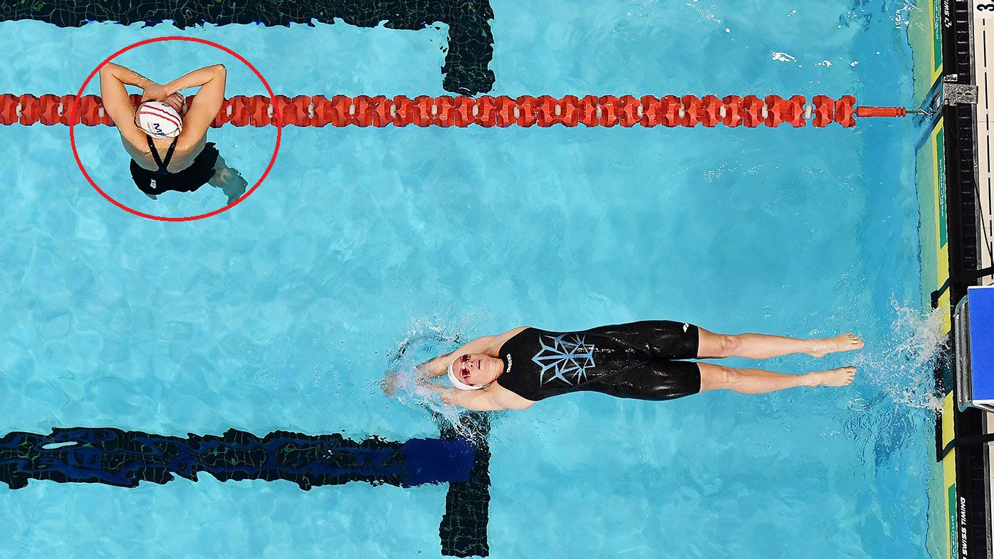 Emily Seebohm starts the heats of the 200 metres backstroke while the swimmers from the previous heat move to the side.