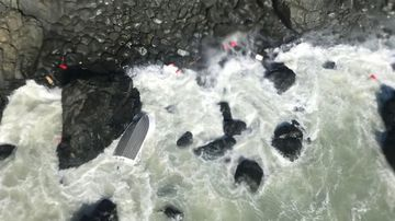 Fishermen found clinging to rocks after 13 hours stranded at sea