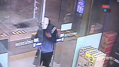CCTV captured the moment the first bandit entering the service station. (9NEWS)
