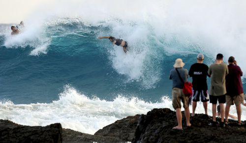 Wild winds and torrential waves batter the Queensland coast.