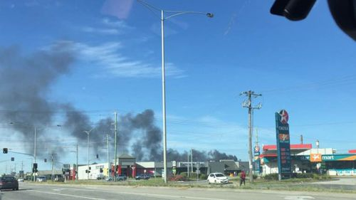 A large fire is burning at a factory in Dandenong South. (Sharon A Leach via Facebook).