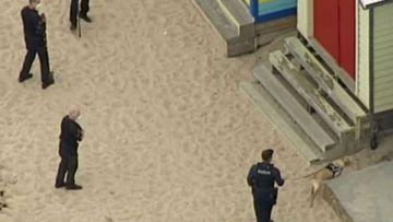 Victoria Police search the area around a beach box on the Mornington Peninsula.