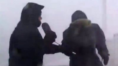 The Weather Channel's Mark Robinson and Chris Scott aren't the first reporters to be knocked about by wild weather in the line of duty. (The Weather Network/YouTube)