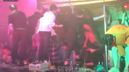 People attempt to support the ceiling of the Coyote Ugly night club after a balcony collapses.
