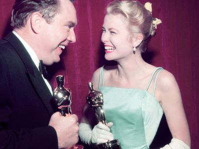 Grace Kelly celebrates at the 1955 Oscars