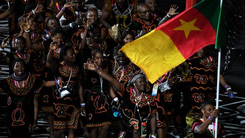 Athletes from Cameroon enter the stadium for the Opening Ceremony. (AAP)