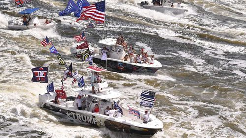 A flotilla of watercraft join a boat parade for President Donald Trump in Florida.