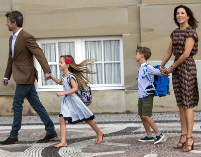 And away they go! Princess Josephine and Prince Vincent head inside to join their elder siblings at school.