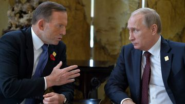 Tony Abbott speaks with Russian President Vladimir Putin. (AAP)