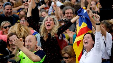 Crowds celebrate outside Catalonia's parliament as the region declares independence from Spain. (AAP)