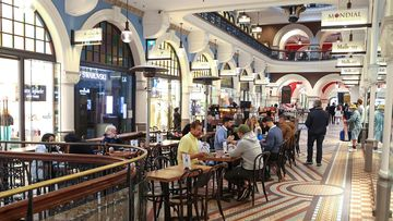Diners are able to sit down for a meal inside the QVB in Sydney for the first time since June. Sydney reopening