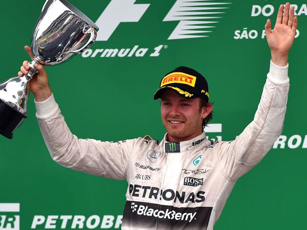 Nico Rosberg with the Brazil F1 trophy. (AFP)