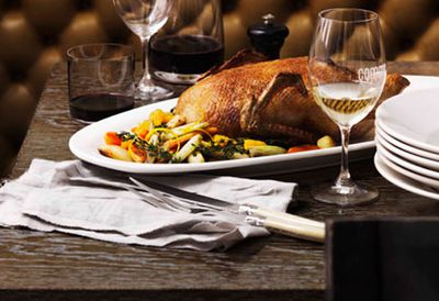 Whole roast duck with winter vegetables and orange