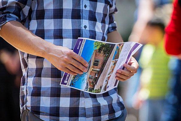 man holding house brochure