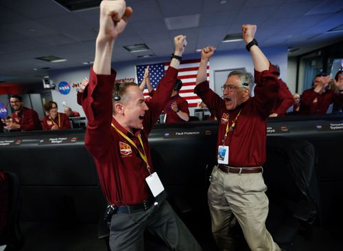 Jubilation at NASA after InSight touches down on Mars.