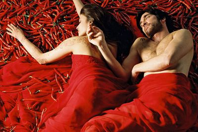 Let's not leave out the delicious offering of Bollywood! The stunning Aishwarya Rai Bachman <i>loves</i> her spices, until a forbidden lover (Dylan McDermott) tries to take her away from it all. Cue some pretty awkward spice mixing scenarios. Yes that is Aishwarya and Dylan lying on a pile of chillis in a state of post-coital bliss. Man, that's gotta burn!<br/><br/>(Image: Rialto Entertainment)