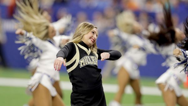 Ella Whistler, who was shot seven times in the May shooting at Noblesville West Middle School, performs with the Indianapolis Colts cheerleaders during the first half of the Colts' NFL football game.