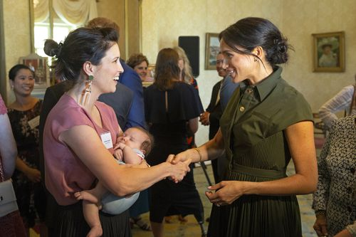 Missy Higgins and daughter Luna caught Meghan's attention at the afternoon reception at Admiralty house.