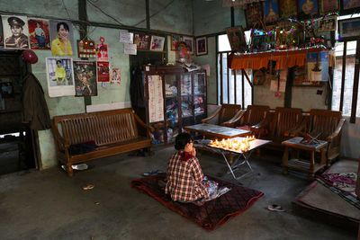 Prayer time in a house in Yangon, Myanmar (2014).