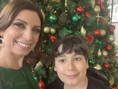 Jo Abi and son Philip standing in front of a Christmas tree