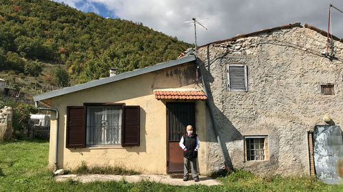 Nobili, seen outside his home, says he loves the simplicity of life in the deserted town.