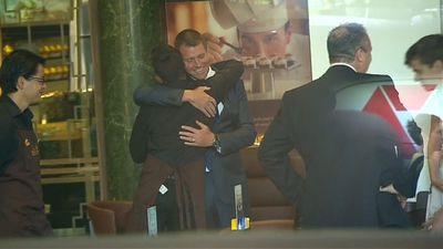In the aftermath of the Martin Place siege, Mr Baird met with staff during the re-opening of the cafe. (9NEWS)