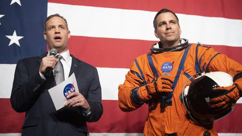 NASA administrator Jim Bridenstine, left, speaks during a demonstration by Dustin Gohmert, wearing a NASA spacesuit prototype for lunar exploration, launch and re-entry aboard the agency's Orion spacecraft, known as the Orion Crew Survival Suit.