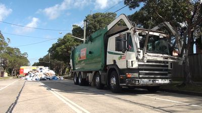 A garbage truck catches on fire. (9NEWS)