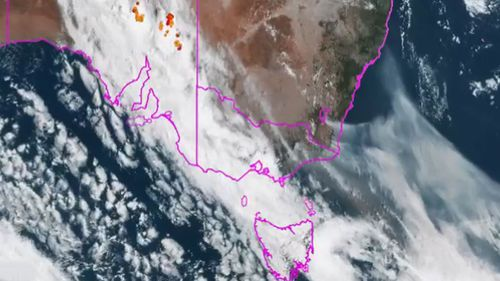 The satellite is showing smoke from fires in the ACT, NSW and Gippsland fire streaming into the Tasman.
