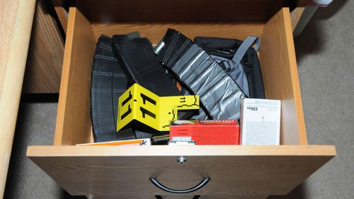 Amunition supplies and two loaded 12ga shotgun magazines taped together from top drawer of filing cabinet of the computer room in the house where Adam Lanza lived with his mother.