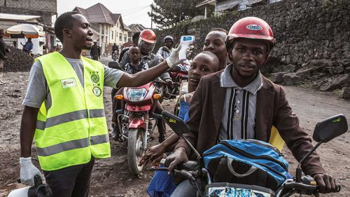 Locals in the city of Goma have their temperature checked after a case of Ebola there.