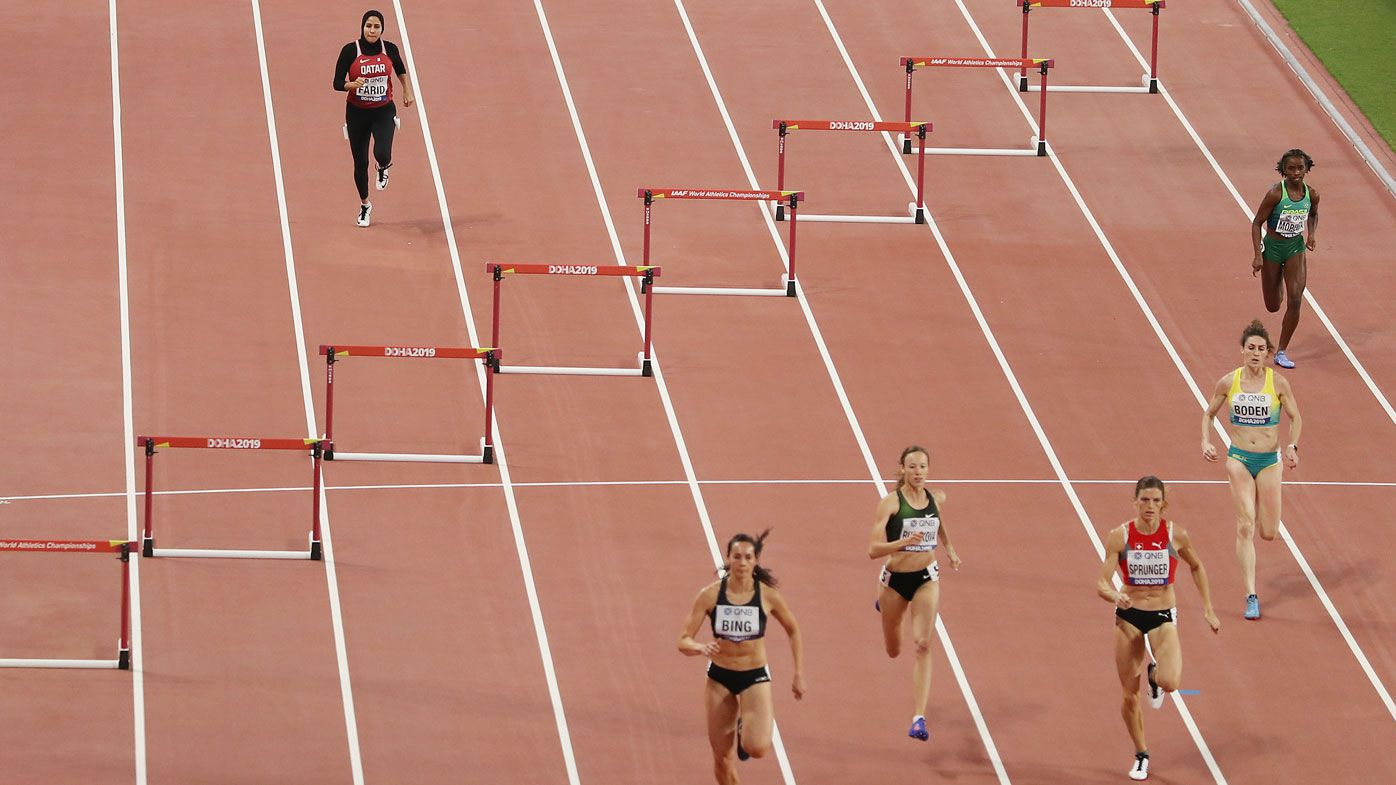 Mariam Mamdouh Farid of Qatar competes in the Women's 400 Metres Hurdles heats