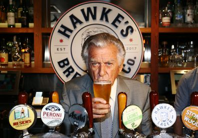 Bob Hawke drinks his own beer at the launch of Hawke's Lager in 2017.