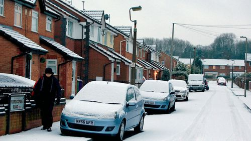 Residents in Liverpool, north-west England, wake up to a snowy morning. (AP).