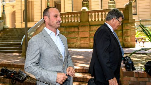Christian Paul Warburton (left) leaves the Central Local Court in Sydney, Tuesday, November 19, 2017. (AAP)