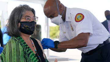 Miami-Dade County Mayor Daniella Levine Cava gives a thumbs up after getting her first dose of Pfizer's COVID-19 vaccine. Once the epicentre for the virus in the US, Florida is still seeing thousands of infections a day. (AP Photo/Wilfredo Lee)