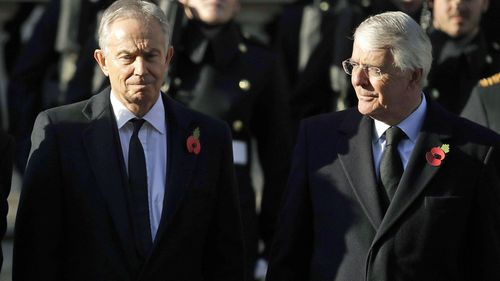 Former British Prime Ministers Tony Blair, left and John Major attend the Remembrance Sunday ceremony at the Cenotaph in Whitehall in London (Photo: November, 2019)