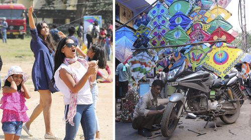 Women fly kites and, right, a street seller shows off his range of colourful wares. (AAP)