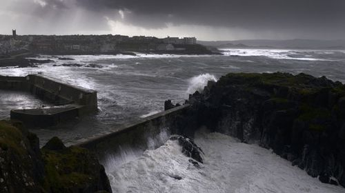 Waves crash against the harbour wall at Portstewart in Northern Ireland. (Getty)