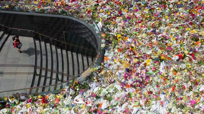<p>Relatives of Katrina Dawson and Tori Johnson have visited a makeshift memorial in Martin Place, joining thousands continuing to grieve for the two victims of the Sydney siege.</p><p> As authorities face mounting pressure to explain how Man Haron Monis fell off watch lists and had access to a gun, the families have slowly made their way around the memorial and enormous floral tribute.</p><p> Family members of Ms Dawson were visibly upset as they read cards and embraced each other at the shrine, while the Johnson family shook the hands of strangers during their emotional visit. Ms Dawson, 38, a barrister and mother-of-three, and Lindt cafe manager Mr Johnson, aged 34, were pronounced dead after the dramatic 16-hour standoff ended early on Tuesday.</p><p> NSW Premier Mike Baird says a permanent memorial will be erected in Martin Place when the time is right.</p><p> Prime Minister Tony Abbott says an urgent, wide-ranging review will examine how Monis was granted asylum, citizenship and welfare benefits.</p><p> Mr Abbott says the siege may well have been a preventable atrocity, adding it's been a horrific wake-up call. <i>All images Getty</i></p>